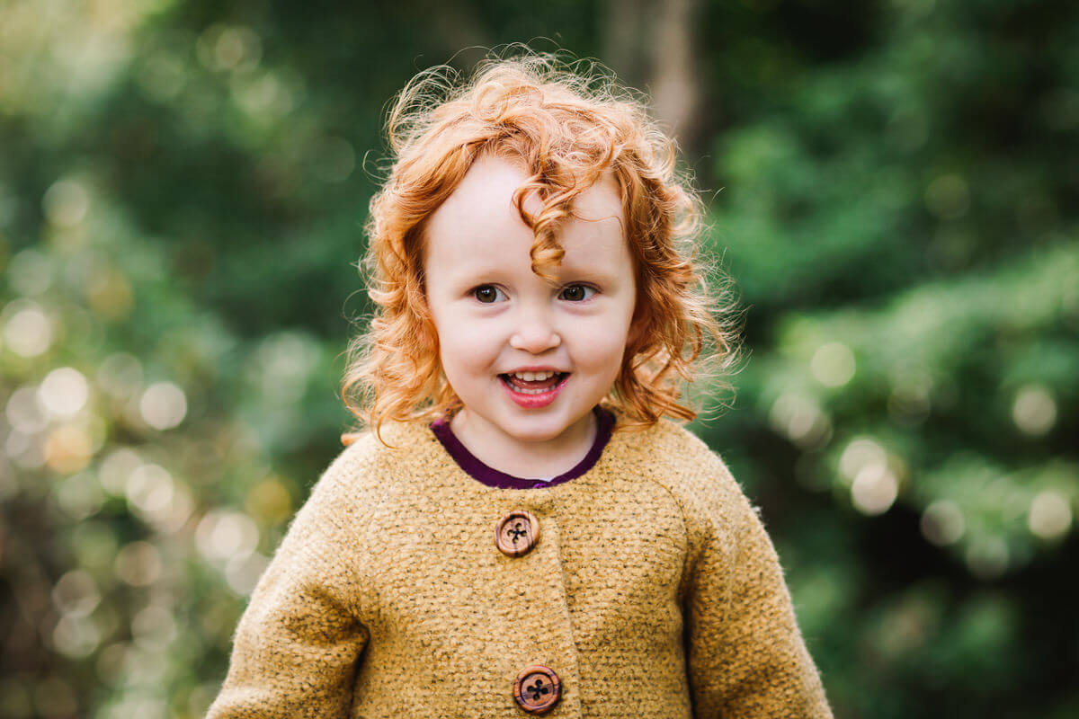 Little girl in mustard coloured cardigan, autumn styled photography