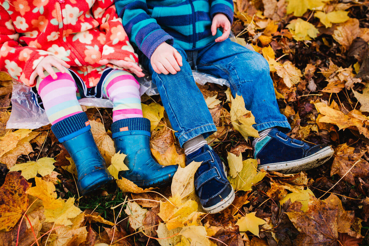 Photograph of childrens shoes in the autumn leaves